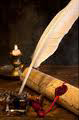 quill pen, scroll, candle